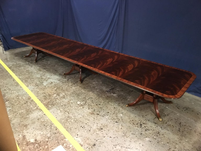 This is a made-to-order large traditional mahogany banquet/dining table made in the Leighton Hall shop. It features a field of slip-matched swirly crotch mahogany from West Africa and a Santos Rosewood border. It has a hand rubbed and polished
