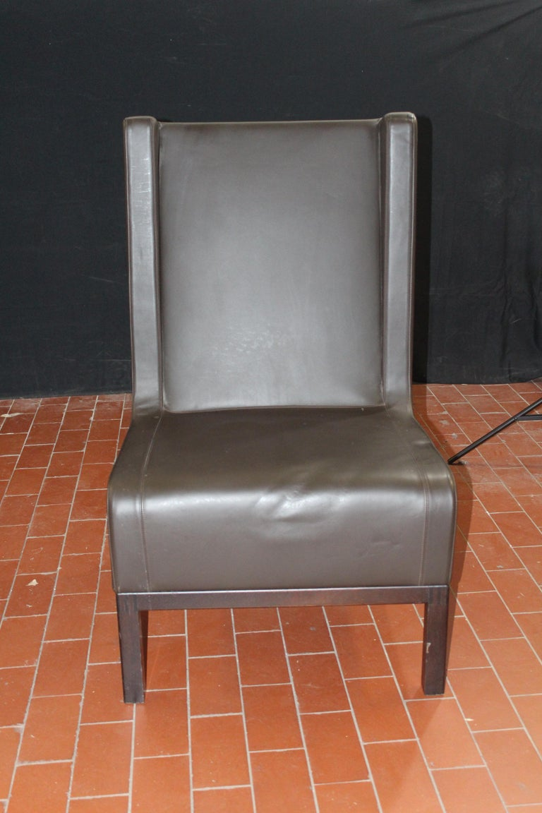 Custom leather side chair in a rich brown leather on matched finished bases.