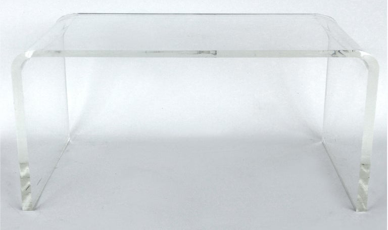 Custom Lucite waterfall table or bench with curved sides  Offered for sale is a Mid-Century Modern style 3/4