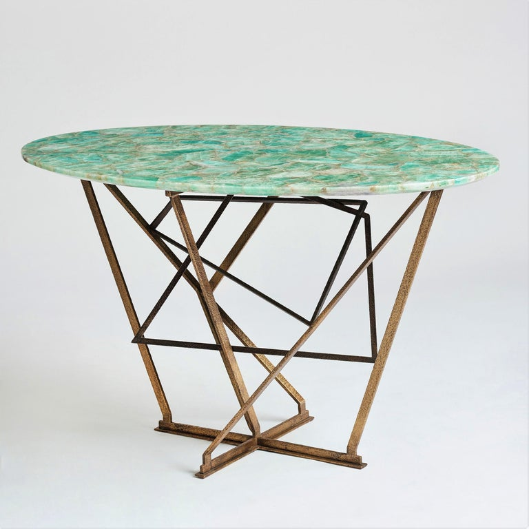 A unique Center table or Console table from Gareth Devonald Smith. Cubist base made of hand-hammered brass with two patinas and a particularly beautiful tabletop in an emerald green fluorite semi-precious stone. The table top was hand-assembled with