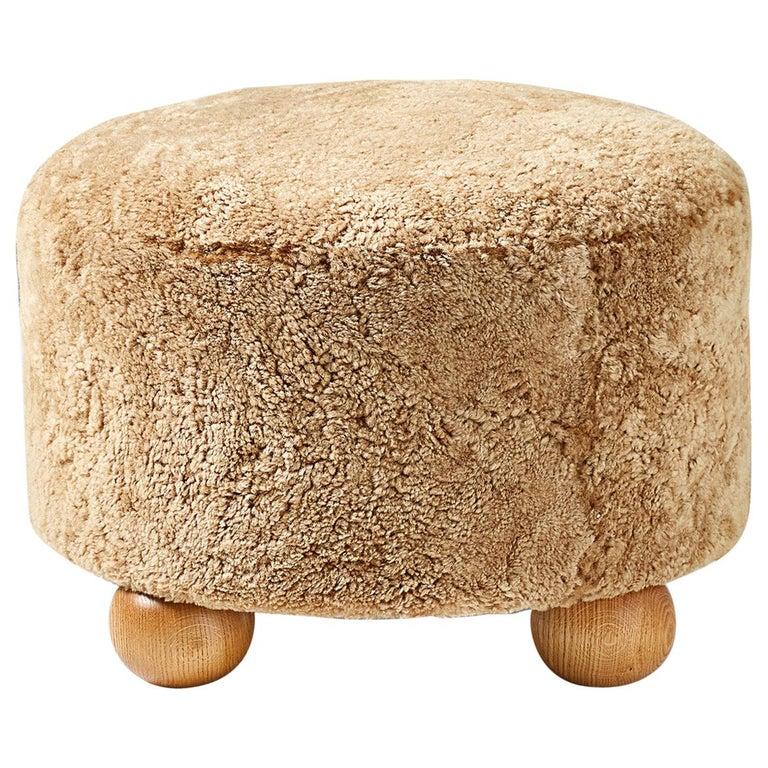Custom Made Round Sheepskin Ottoman with Oak Ball Feet For Sale