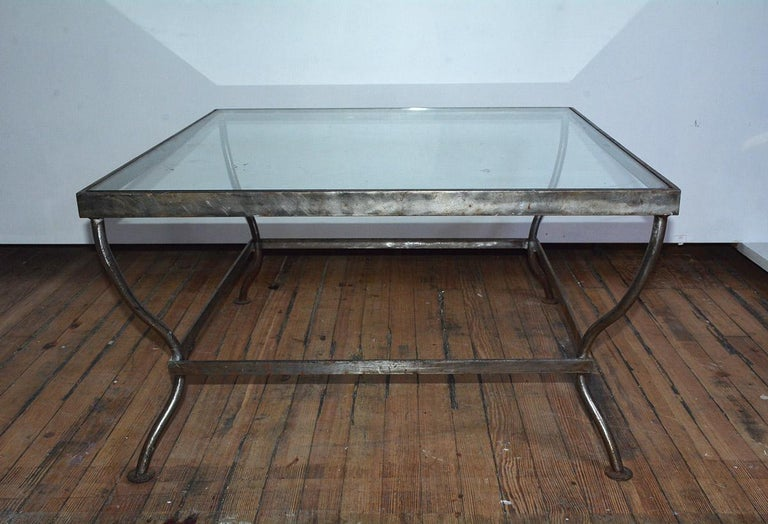 Custom made to size, Mid-Century Modern Industrial style glass and polished iron coffee table. Can be made to customer specification. Similar design available in dining table or side table versions. 