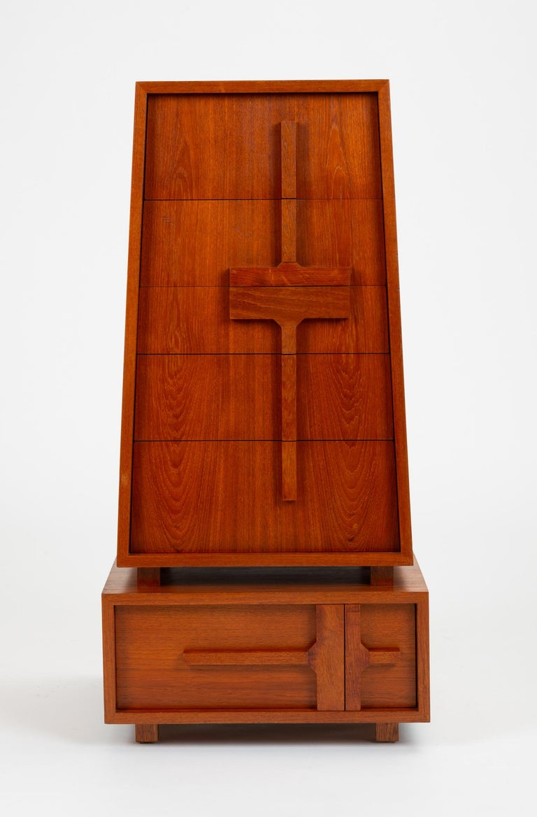 An unusual and compelling design for a tiered chest of drawers, likely a custom woodworking project. The piece has a square base with a single, deep drawer. Four spacers separate an upper case piece with a sloped sides containing five drawers of