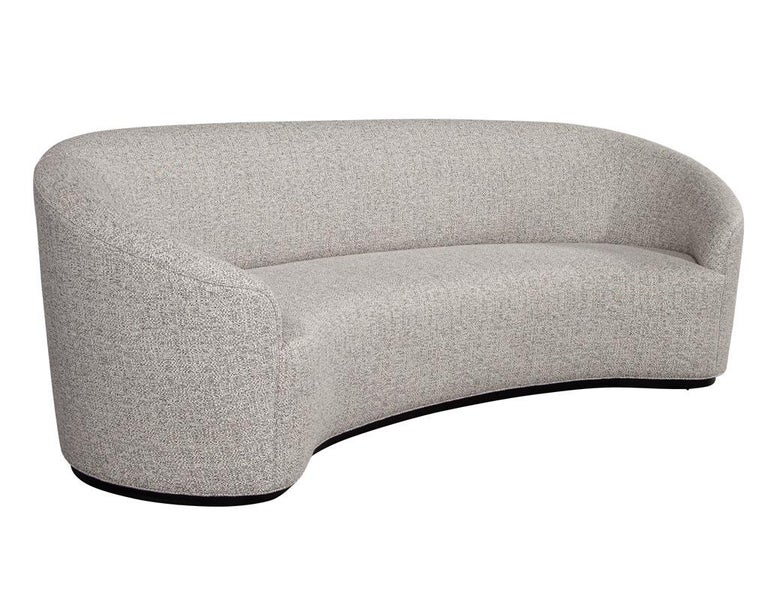 Custom modern curved sofa in grey textured linen. Designed and handcrafted here at Carrocel in Toronto Canada. A true masterpiece of design and styling. This sofa is made to order with lead times of 10-12 weeks.