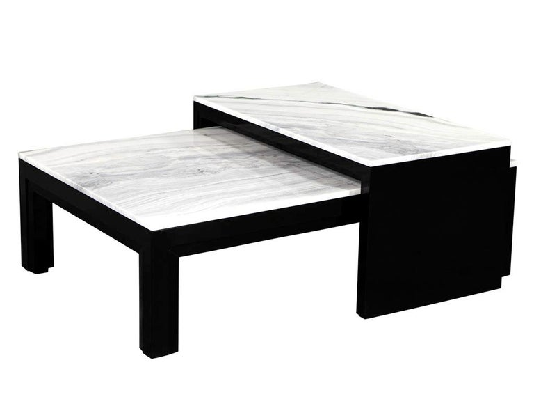"""Custom stone top nesting coffee cocktail table. Finished in a hand polished black lacquer and exclusive stone tops. Table has an extending gliding section for serving and extra space.  Measures: Main coffee table W 54"""", H 16"""", D 36"""" Top table W"""