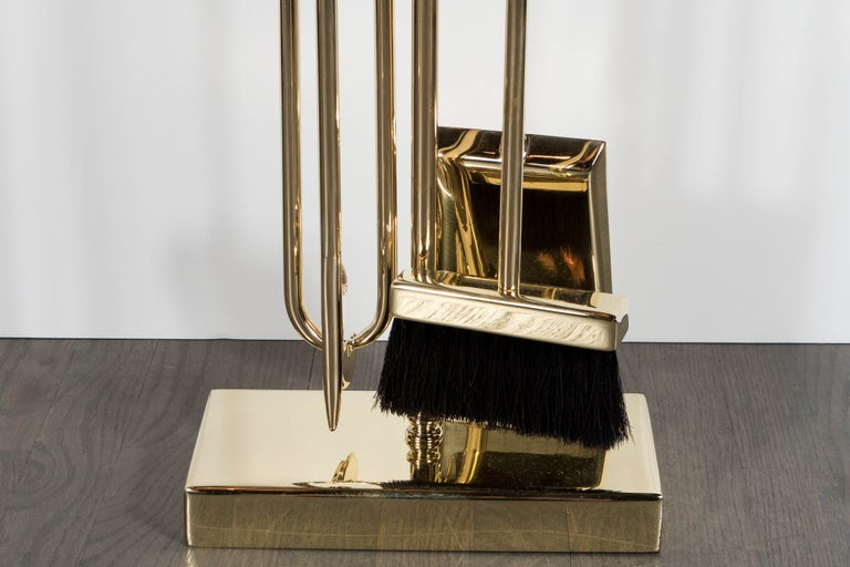 This refined and elegant modernist four-piece fire tool set was custom realized by artisans in New York State, exclusively for us. It features a shovel, brush, log holder and poker suspended from a notched rectangular top supported by a cylindrical