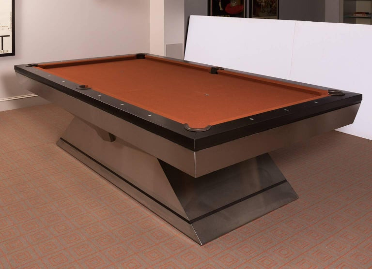 Custom-made monarch pool table that features Walnut rails with brushed stainless steel frame. Full rack included.