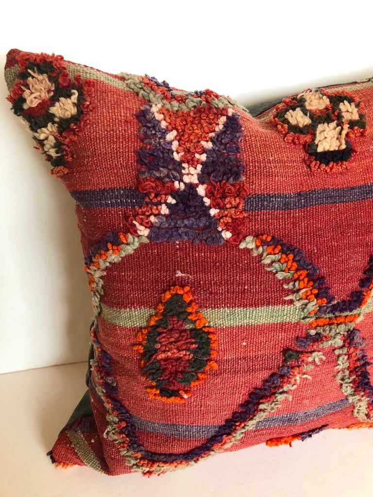 Custom pillow cut from a vintage hand loomed wool Ait Bou Ichaouen Moroccan Berber rug, one of the most remore, isolated tribes in Morocco. Bold colors and patterns reflect an older North African tradition unlike those from elsewhere. The pillow is