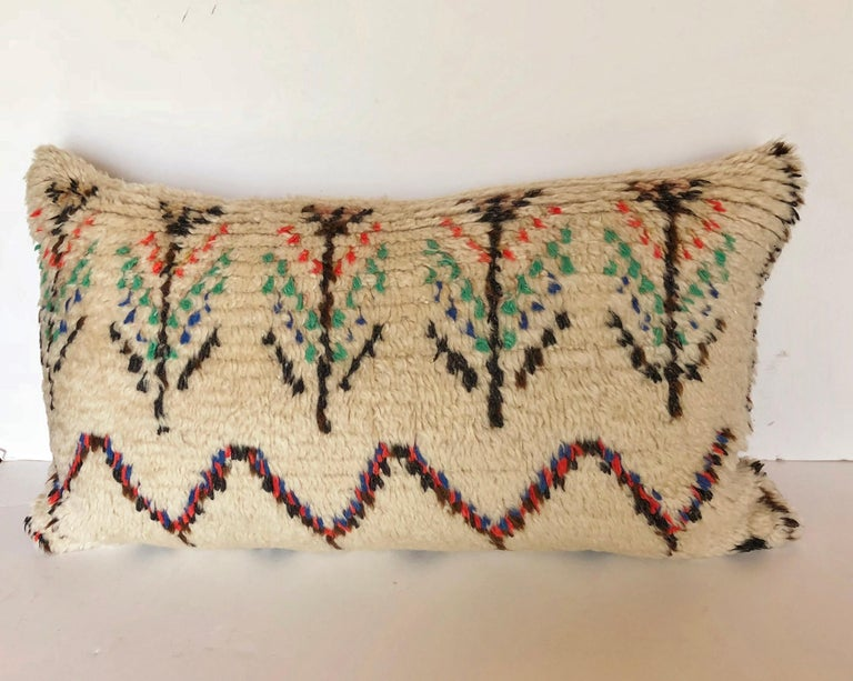 Custom pillow cut from a vintage hand loomed wool Moroccan Azilal rug from the Atlas Mountains. Wool is soft and lustrous with all natural dyes. Pillow is backed in cream mohair, filled with a 100% down insert and hand sewn closed. We make all of