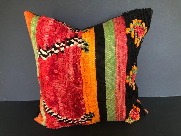 Custom pillow cut from a vintage hand loomed wool Moroccan Ait Bou Ichaouen Berber rug, one of the most isolated tribes in the Atlas Mountains. Bold striking colors and patterns reflect an older North African tradition unlike those found elsewhere.
