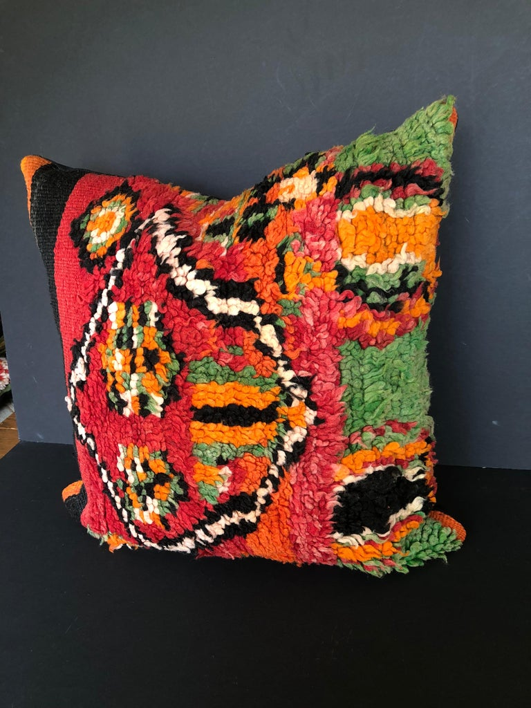 Custom pillow cut from a vintage hand loomed wool Moroccan Ait Bou Ichaouen Berber rug, one of the most remote, isolated tribes in Morocco. Bold, striking colors and patterns reflect an older North African tradition unlike those from elsewhere. The