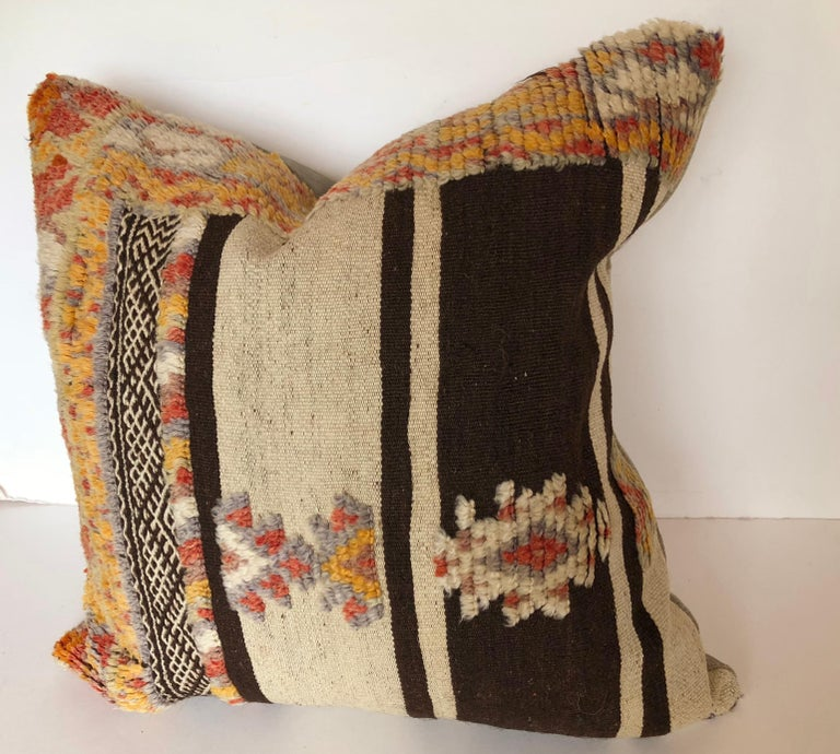 Custom pillow cut from a rare vintage hand loomed wool Moroccan Glaoui rug made by the Berber tribes of the Atlas Mountains. Wool is soft and lustrous with all natural dyes. Flat-weave stripes are embellished with wool tufted tribal designs. Pillow