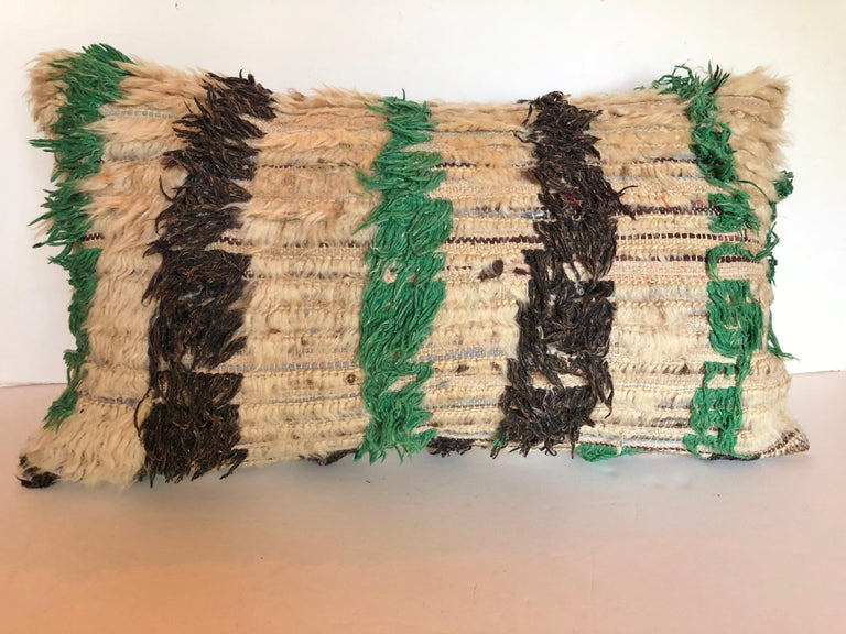 Custom pillow cut from a vintage hand loomed wool Moroccan Berber rug from the Atlas Mountains. The wool is soft and lustrous, Pillow is backed in a linen blend, filled with an insert of 100% down and hand sewn closed. We make all of our pillows