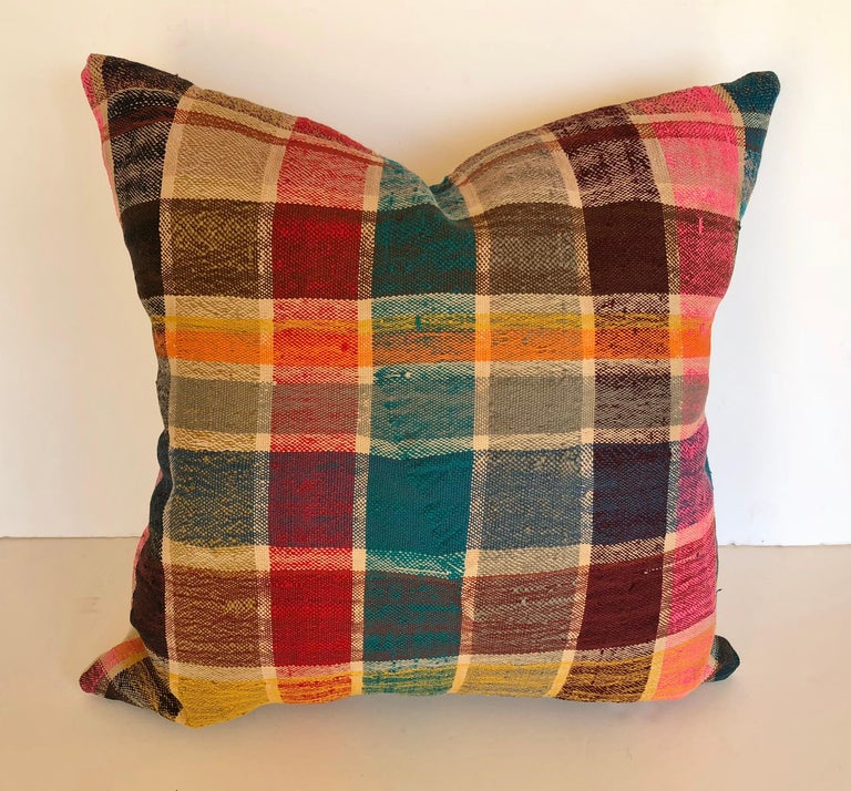Custom pillow cut from a vintage Moroccan hand loomed cotton haik or Berber shawl from the Atlas Mountains. They are traditionally made in bright colored plaids. Pillow is backed in a linen blend, filled with an insert of 50/50 down and feathers and