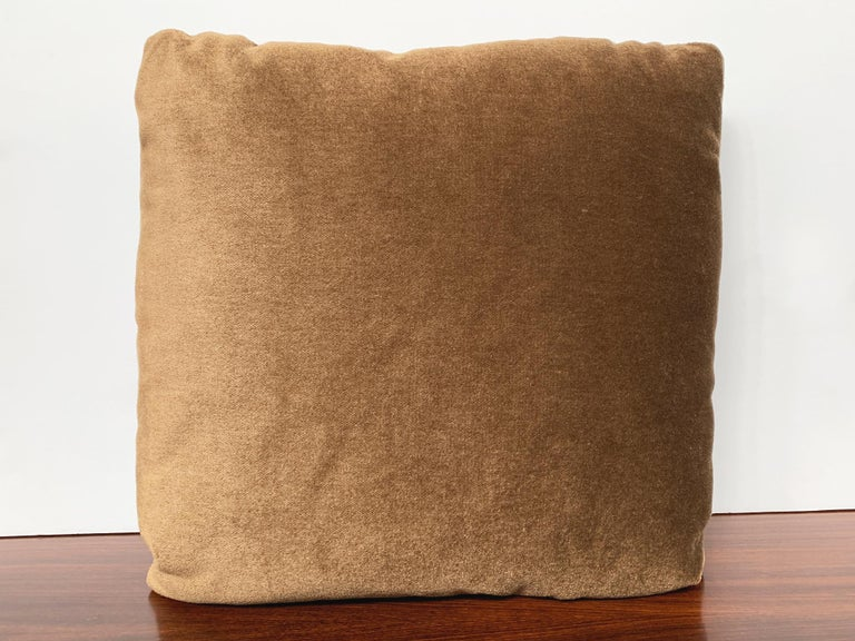 New custom made pillow with mohair velvet from Schumacher. The mohair is smooth and soft. It has a rich coffee brown color that takes on a bronze tone in the light. He filling is a combination of foam and down, very comfortable and ideal for cozy