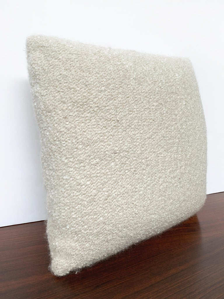 New custom made pillow with a bouclé fabric from Schumacher. The bouclé is soft-textured and has a warm cream-white color. The filling is a combination of foam and down. This is an ideal pillow for lounging comfortably in your sofa or bed. There are