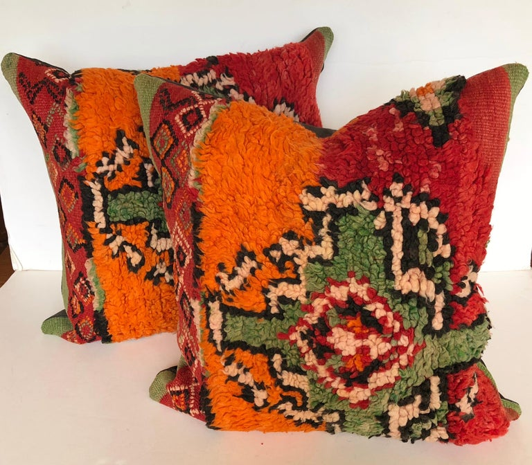 Custom pillows cut from a vintage hand loomed wool Ait Bou Ichaouen Moroccan Berber rug, one of the most remote, isolated tribes in Morocco. Bold striking colors and patterns reflect an older North African tradition unlike those from elsewhere.