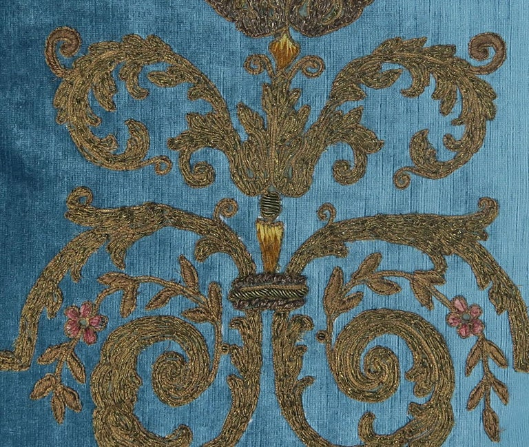 Pair of pillows designed by Melissa Levinson with 19th century fine handmade gold metallic embroideries appliquéd to contemporary blue linen velvet background and heavy coppery bronze silk backs. 19th century handmade trim around the perimeters of