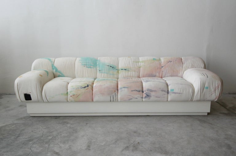 Incredible and large, Postmodern Italian style sofa on a plinth base. Most likely a custom piece, this beauty truly has lines and curves worth coveting. Sofa is large, measuring over 8ft, seats 4-5 people.