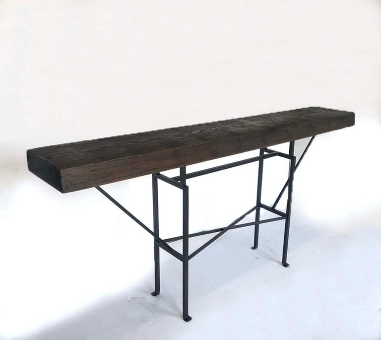 Custom buttress console with a reclaimed Douglas fir top and custom iron base. Can be made in any size and in a variety of finishes. Please see photo. Made in Los Angeles by Dos gallos Studio