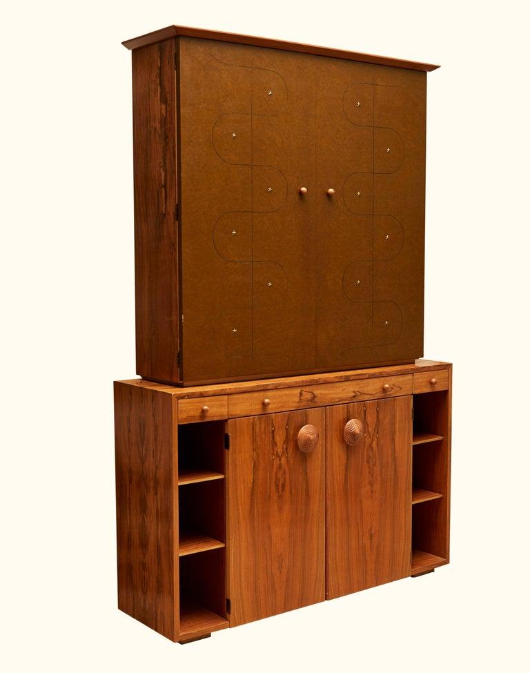 Custom secretary bookcase / cabinet by Gilbert Rohde Paldo for Herman Miller.