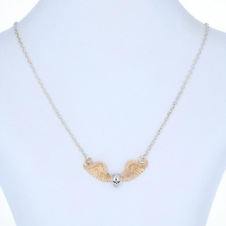 Stand out from the crowd with this unique accessory! Custom-made in sterling silver, this necklace consists of a cable-style chain and a pendant created from a pair of antique 14k yellow gold angel wings. The pendant, which was inspired by