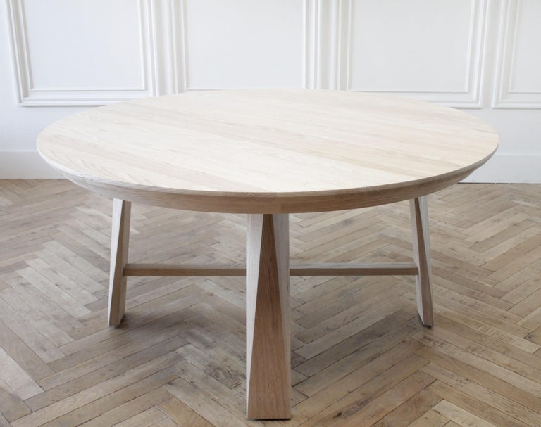 Custom solid white oak round dining table Available for custom ordering, in any size, shown in waxed white oak. We also offer a natural white oak, medium white oak, and onyx stain. Beautiful angular cut legs with stretcher. Tabletop can be removed
