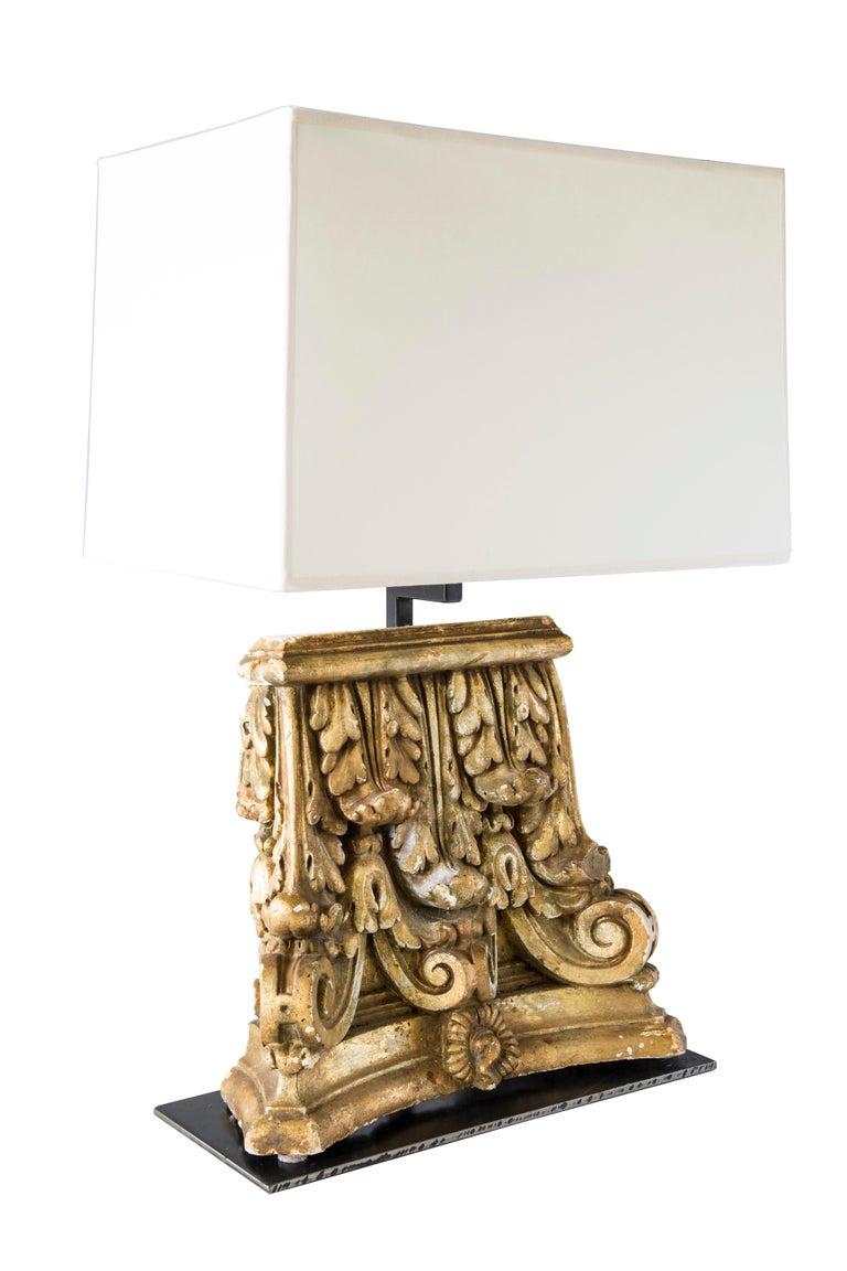 Custom table lamp with gilded capitol fragments.