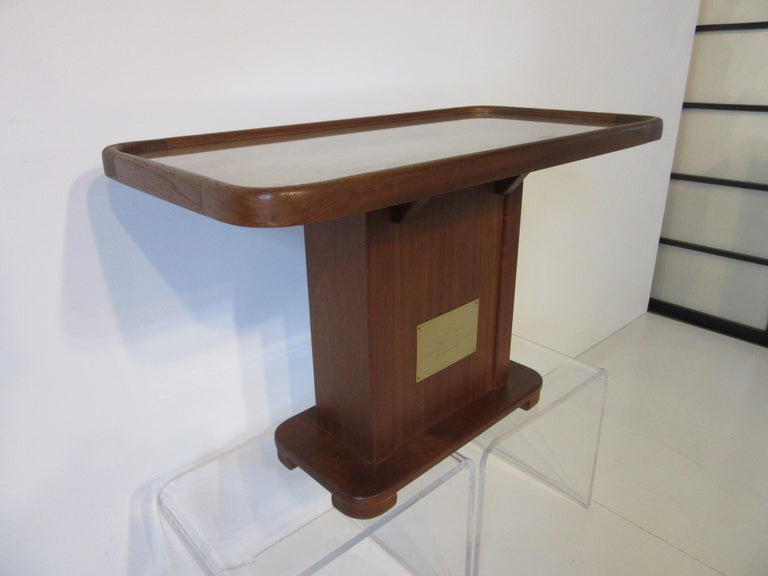 A custom well crafted teak wood side table with brass engraved plaque