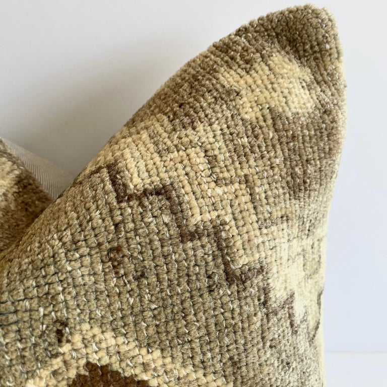 Antique woven rug pillow in natural gray brown and taupe with geometric patterns. The backside is a coordinating cotton. Our pillows are constructed with vintage one of a kind textiles from around the globe. Carefully constructed with the finest
