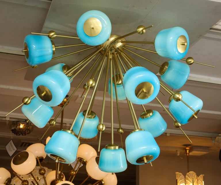 Custom turquoise milk glass flush mount chandelier in polished brass. Customization is available in different sizes, glass colors (white, sanded clear and turquoise) and finishes. G9 base light sockets are used for this chandelier. Please specify