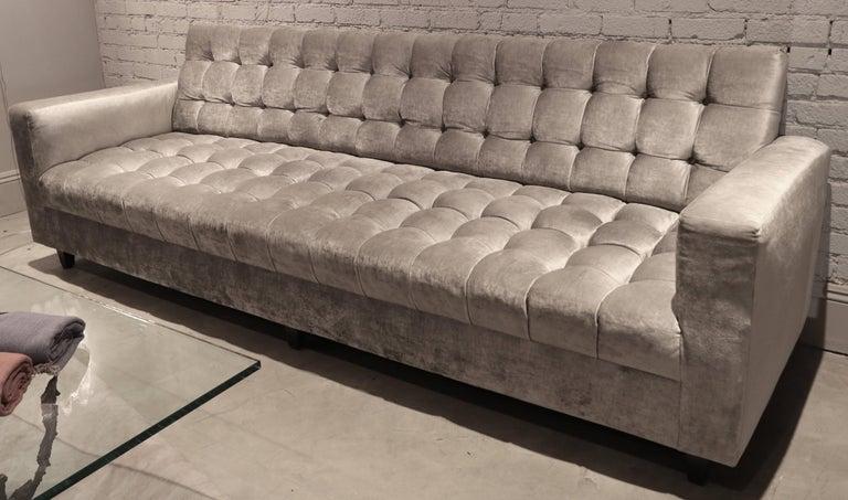 Custom tufted sofa upholstered in grey Brussels velvet.