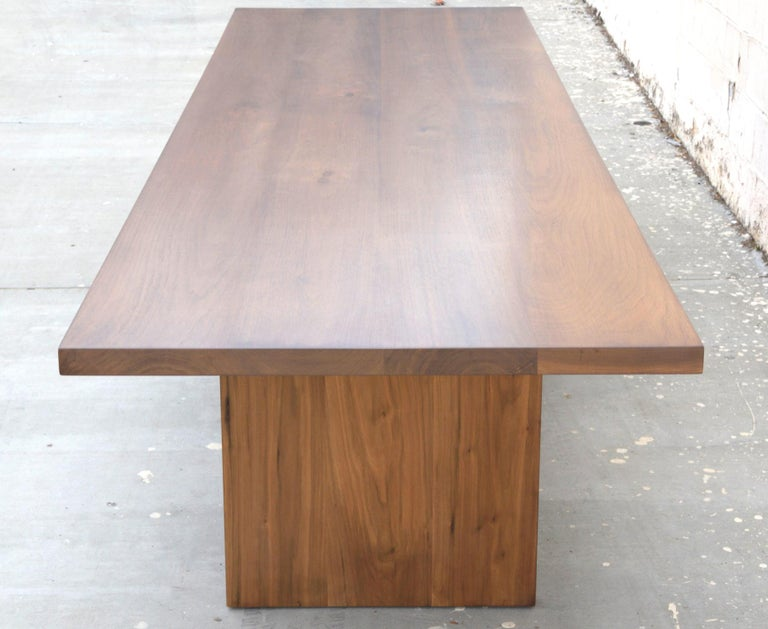 This modern walnut dining table is seen here in 132