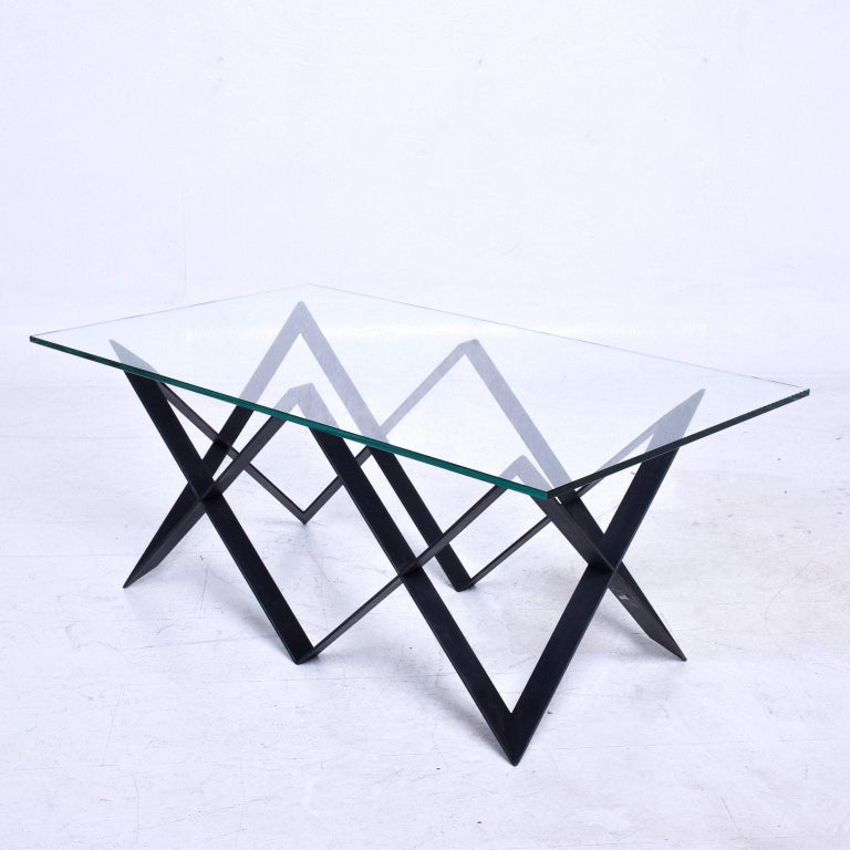 For your consideration a vintage coffee table in iron painted in black with a glass top,  Mexico, circa 1960s.  Measures: Glass top 21