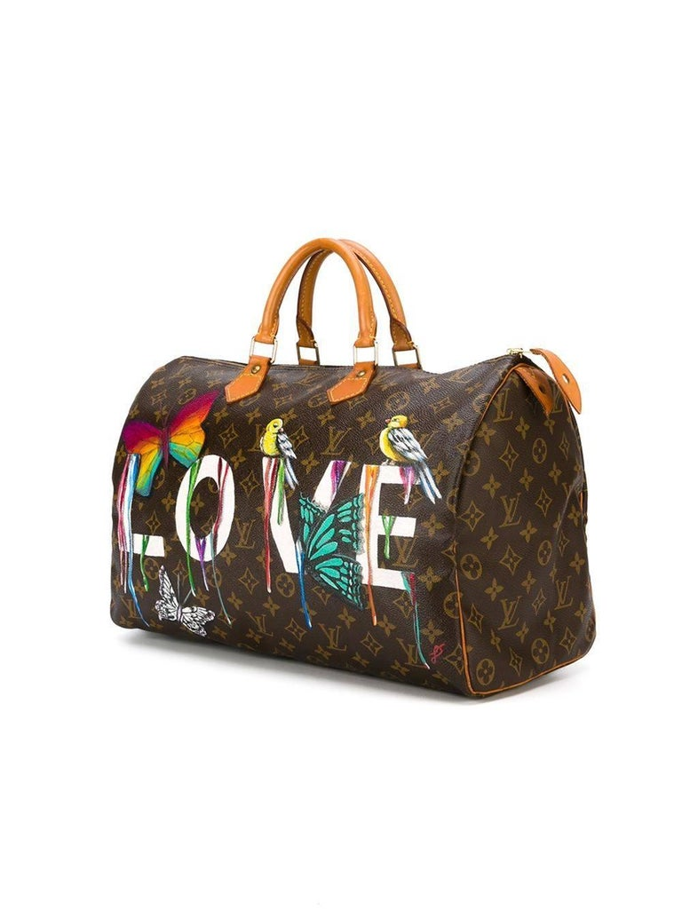 Hand-painted vintage Louis Vuitton monogram leather Speedy bag featuring a customised hand-painted design.   Composition: Monogram Leather   Colour: Brown, Hand-painted design   Rewind Vintage Emotional Baggage  The brainchild of Rewind, these