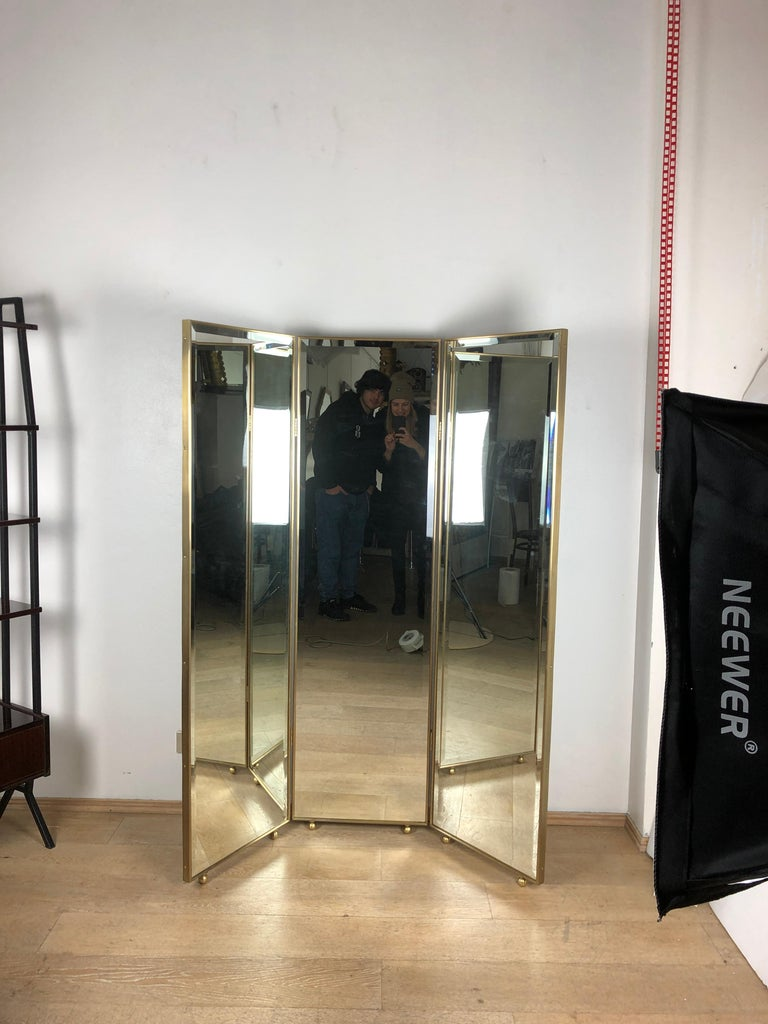 Customizable Art Deco style mirrored three panels brass frame screen  Screen composed by three mirrored panels and brass frames. Ideal as room divider, to decor a fitting room, a wardrobe, a kitchen, to decor a dark edge of a room. This is a