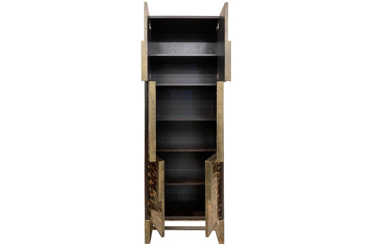 The Chelsea bar cabinet by Ercole Home has a 6-door front, with Espresso wood finish on oak.