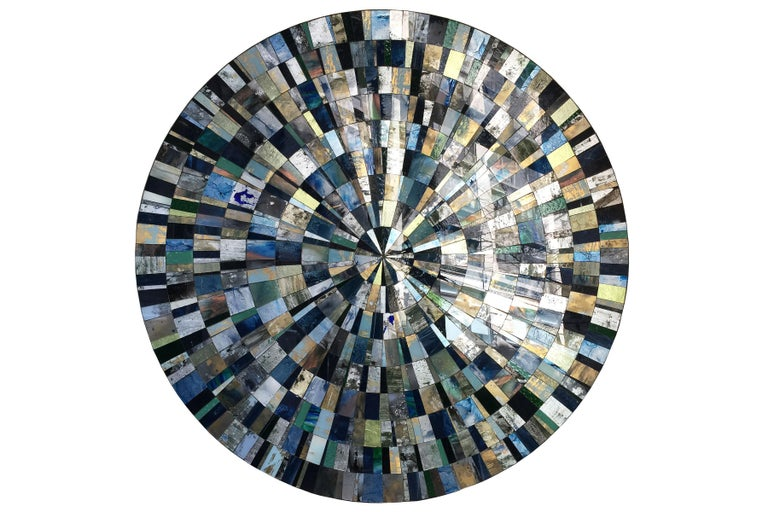 Aqua (églomisé) mosaic coffee table designed by Ercole Home with hand painted glass mosaic surface in Sunburst pattern. The base is made of 1/2