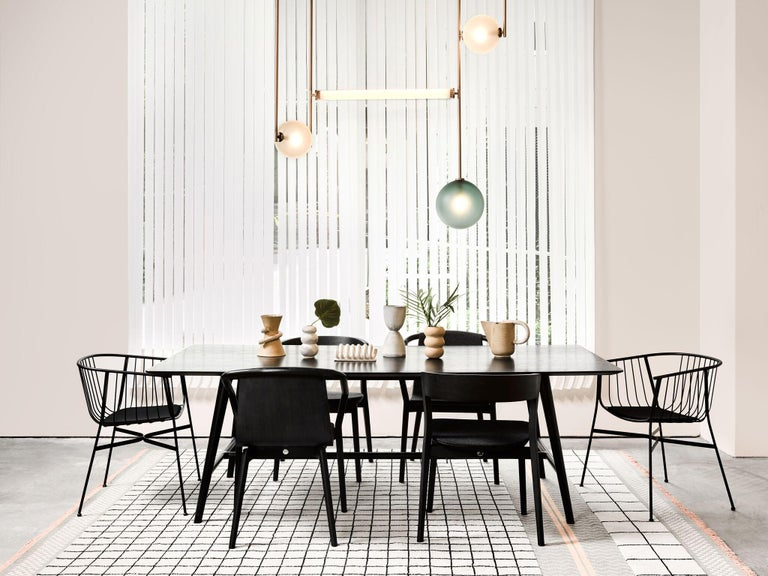 Equalizer was conceived as an exercise in the defining architectural spaces. Taking inspiration from a room divider, the collection's vertical framework undulates through an environment delineating areas through positive and negative space. The