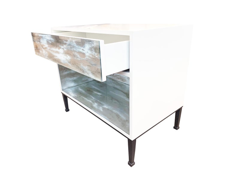The industrial nightstand by Ercole Home has one drawer front, with white lacquer wood finish.