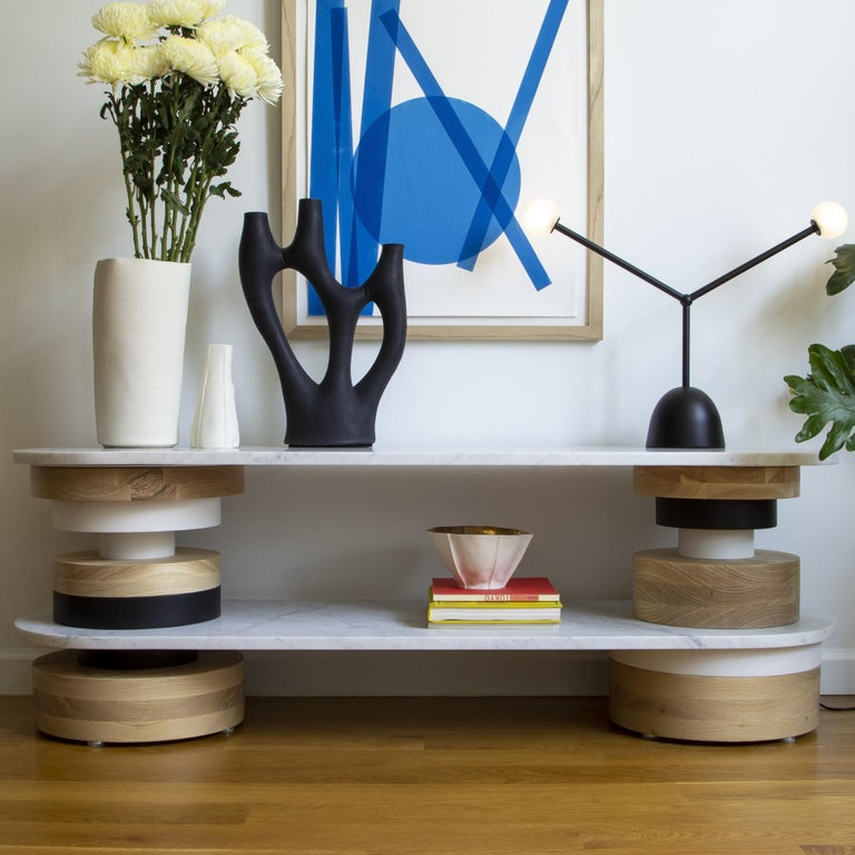 """The Sottsass-inspired """"Sass Console Table"""" is a bold, graphic statement piece. A honed Carrara marble top sits on an Amish-made base composed of painted and stacked wood circles. Made to order.  The version as shown in the first image is 18"""