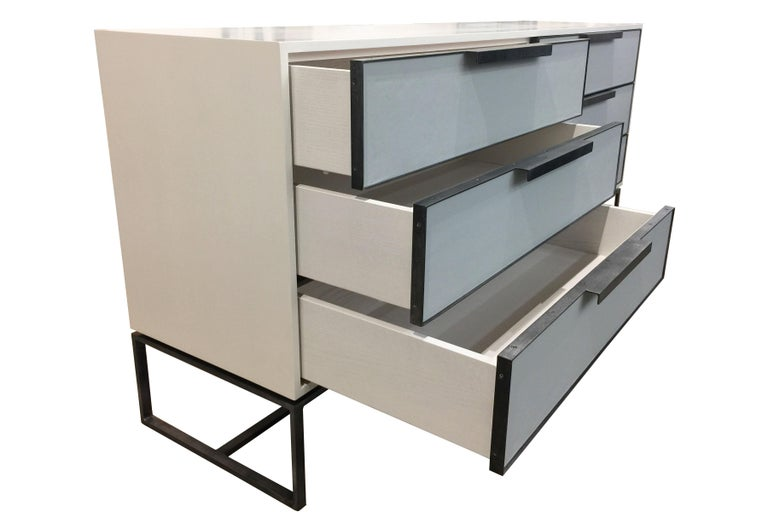 The midcentury leather chest of drawers by Ercole home has a 6-drawers, with Painted Ivory wood finish on oak.