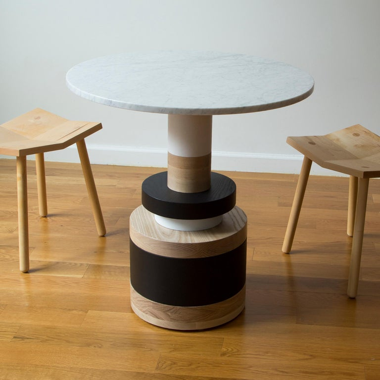 """The Sottsass-inspired """"Sass Dining Table"""" is a bold, graphic statement piece. A polished Nero Marquina marble top sits on an Amish-made base composed of painted and stacked wood circles.   The version as shown is 30"""