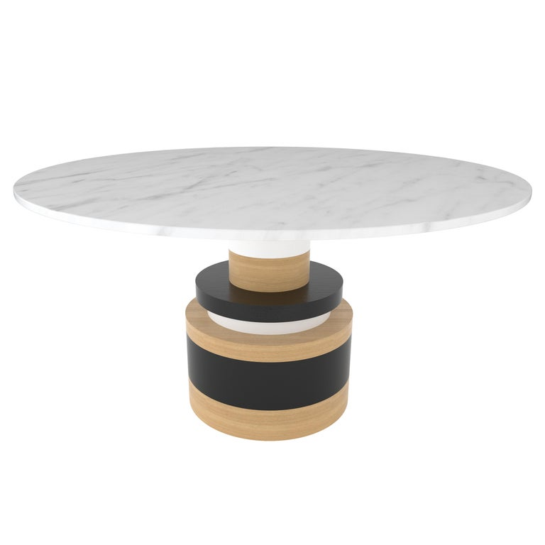 "The Sottsass-inspired ""Sass Dining Table"" is a bold, graphic statement piece. A polished Nero Marquina marble top sits on an Amish-made base composed of painted and stacked wood circles. 