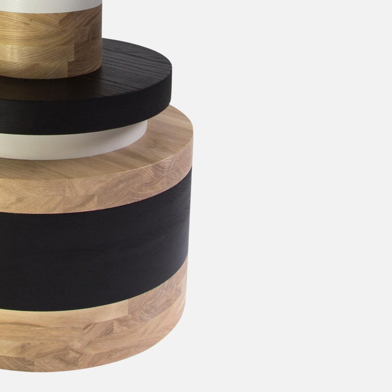 "The Sottsass-inspired ""Sass Dining Table"" is a bold, graphic statement piece. A honed Carrara marble top sits on an Amish-made base composed of painted and stacked wood circles. 