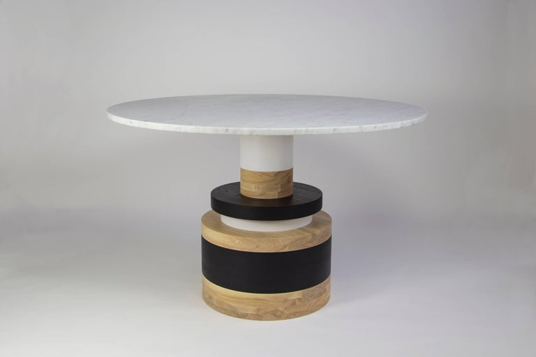 "The Sottsass-inspired ""Sass Dining Table"" is a bold, graphic statement piece. A honed Carrara marble top sits on an Amish-made base composed of painted and stacked wood circles.   The version as shown is 47"