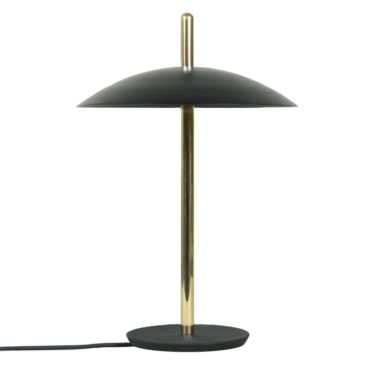 The signal table lamp is familiar, yet futuristic. From beneath its spun metal shade LEDs cast a warm and inviting glow onto a polished central stem grounded by a cast iron base. With its refined form and multiple finish options the signal table