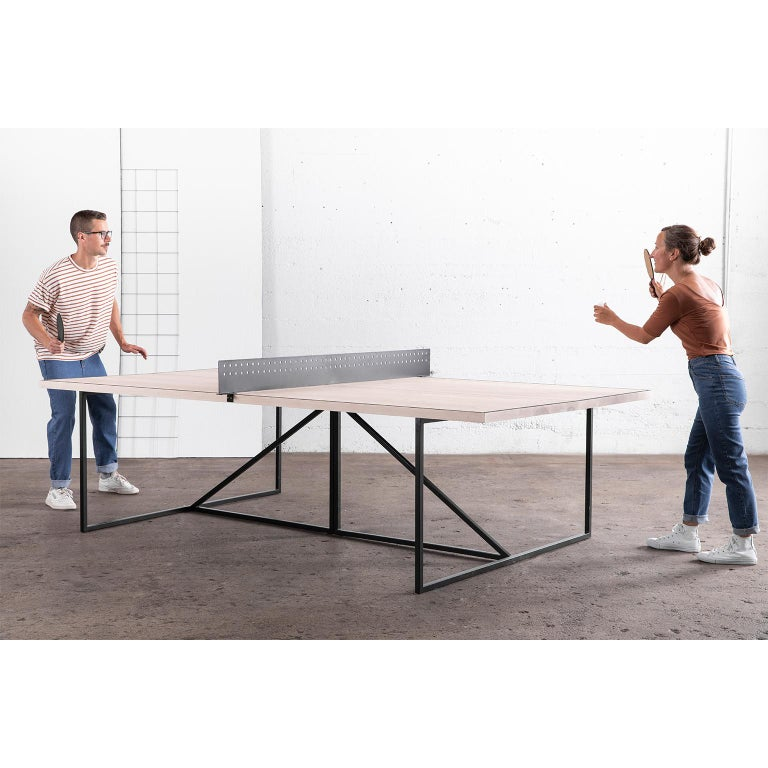 The Break Ping Pong Table gives a modern look to the classic parlour game. You'll play like a professional on the table's matte wood playing surface. The frame of the table is hand-welded from durable steel and can be finished in one of our three