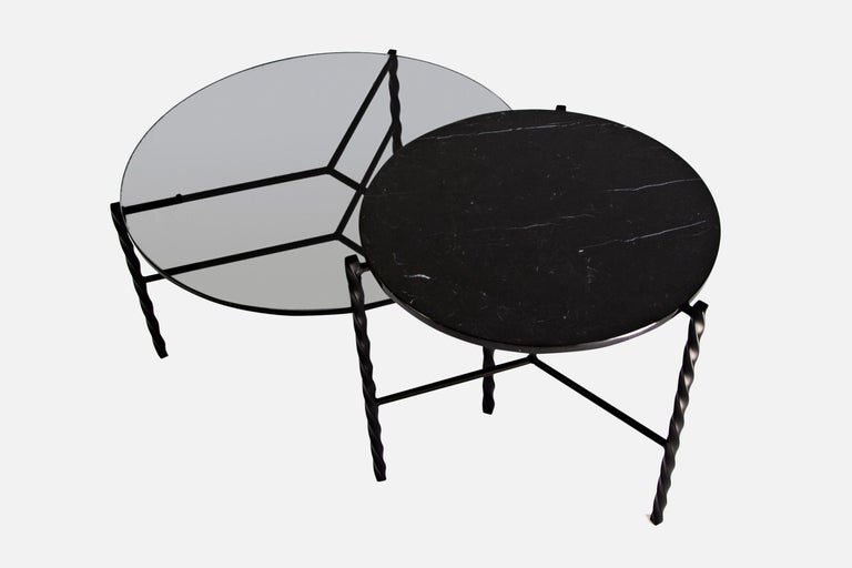 This piece is a floor model that was used at a trade show for a few days. It's in like-new condition with very minimal wear.  The Von Iron series consists of coffee and side tables with a distinctive twist. Inspired by traditional blacksmith