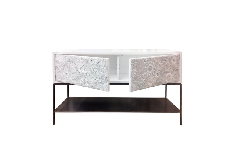 """The Blossom serving buffet by Ercole Home has a 2-door front, with metal base in bronze finish. The metal shelf is 5"""" H off the floor. Handcut glass mosaic in variety shades of white and ivory decorate the surface in Blossom mosaic pattern. White"""